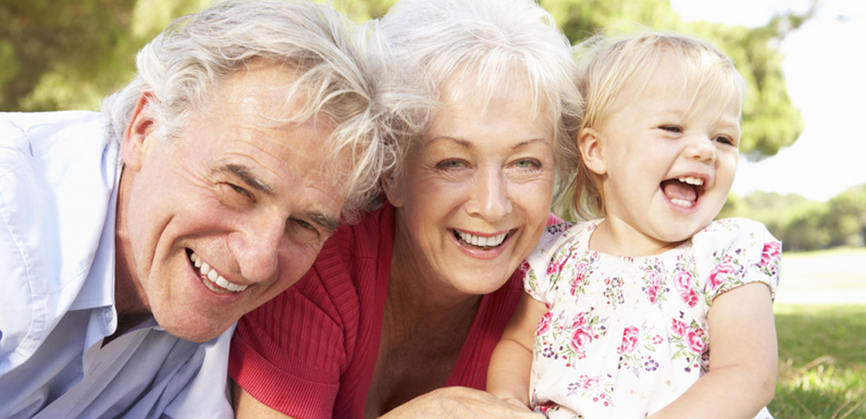 Smiling Older Couple with Child